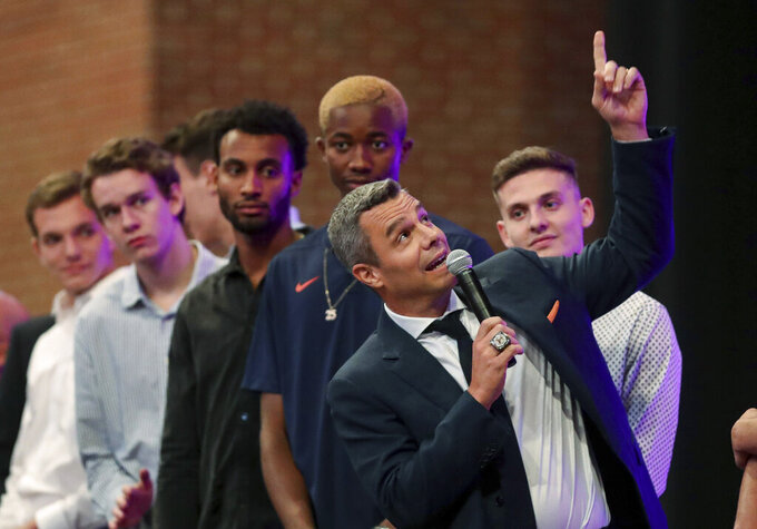 Virginia coach Tony Bennett speaks at the start of a celebration of Virginia's NCAA men's basketball title, Friday, Sept. 13, 2019, in Charlottesville, Va. A banner was raised at John Paul Jones Arena. (Andrew Shurtleff/The Daily Progress via AP)