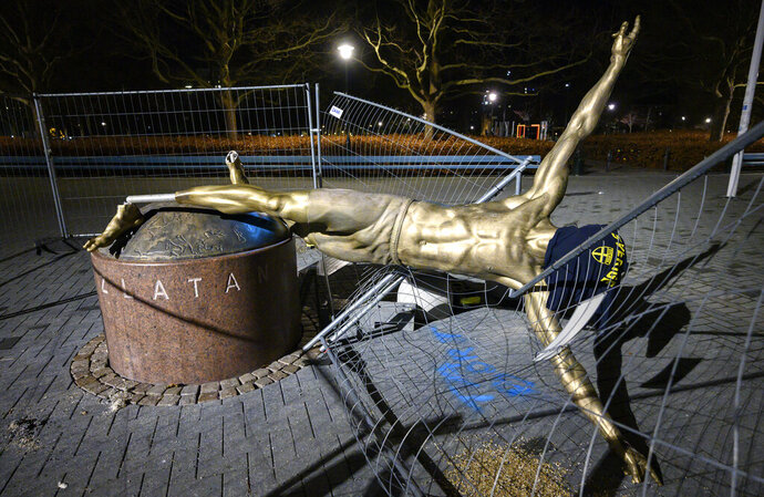 FILE - In this Sunday Jan. 5, 2020 file photo, the damaged statue of soccer player Zlatan Ibrahimovic next to Stadion football arena in Malmo, Sweden.  Media reports say the city of Malmo has had enough of repeated acts of vandalism on Swedish soccer star Zlatan Ibrahimovic's statue outside the local football club's stadium and is set to move it to a new location. The Sydsvenskan newspaper said the municipal council in Sweden's third largest city is poised to make a decision on Monday, May 17, 2020 and is seeking suggestions from top-flight team Malmo FF as to where the statue should be moved later in the year.(Johan Nilsson/TT via AP, file)