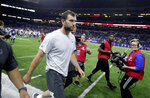 Indianapolis Colts quarterback Andrew Luck leaves the field following the team's NFL preseason football game against the Chicago Bears, Saturday, Aug. 24, 2019, in Indianapolis. Chicago won 27-17. (AP Photo/Michael Conroy)