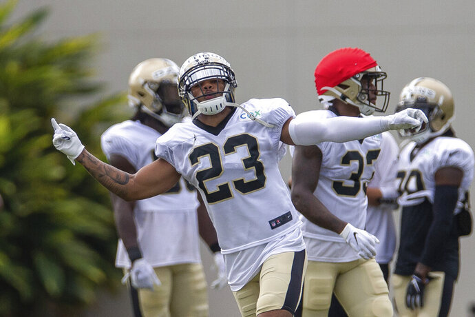 New Orleans Saints cornerback Marshon Lattimore (23) reacts to catching a pass during an NFL football training camp practice at the Ochsner Sports Performance Center in Metairie, La., Friday, Aug. 28, 2020. (David Grunfeld/The Advocate via AP, Pool)