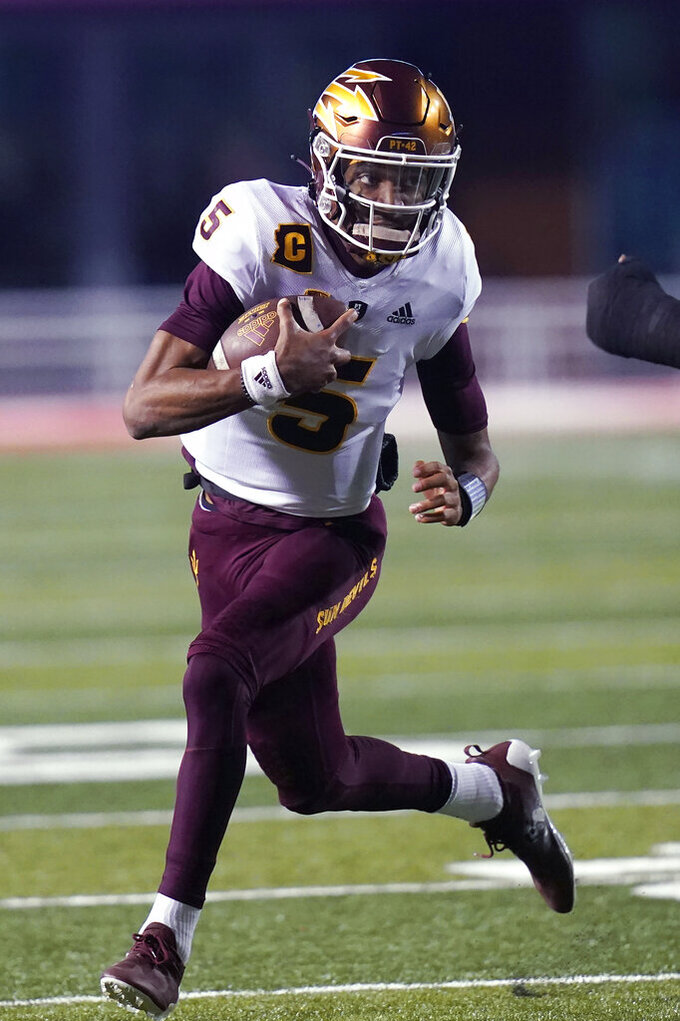 Arizona State quarterback Jayden Daniels carries during the first half of the team's NCAA college football game against Utah on Saturday, Oct. 16, 2021, in Salt Lake City. (AP Photo/Rick Bowmer)