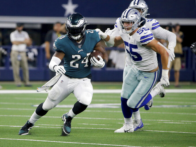 Philadelphia Eagles running back Jordan Howard (24) runs the ball as Dallas Cowboys outside linebacker Leighton Vander Esch (55) gives chase in the first half of an NFL football game in Arlington, Texas, Sunday, Oct. 20, 2019. (AP Photo/Michael Ainsworth)