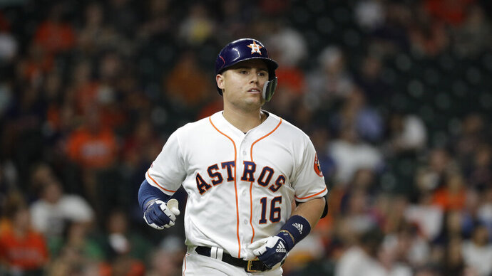 FILE - In this Sept. 5, 2019 file photo Houston Astros' Aledmys Diaz runs toward first base during the fifth inning of a baseball game against the Seattle Mariners in Houston. Diaz went to arbitration Monday, Feb. 17, 2020 with the Astros, who offered the same $2 million salary he earned last year. Diaz asked for a raise to $2.6 million. (AP Photo/David J. Phillip, file)