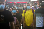 People crowd the commuter train platforms at Atocha station in Madrid, Spain, Thursday, Aug. 27, 2020. Authorities in Madrid, the hottest spot in Spain's new surge of coronavirus contagion, said Wednesday they only consider very localized stay-at-home orders for the worst-hit areas of the Spanish capital, discarding the idea locking down the city of 3.3 million. (AP Photo/Andrea Comas)