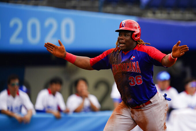 Dominican Republic's Johan Mieses reacts after scoring on a RBI double by Melky Cabrera during the bronze medal baseball game against South Korea at the 2020 Summer Olympics, Saturday, Aug. 7, 2021, in Yokohama, Japan. (AP Photo/Matt Slocum)