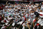 Members of the Miami of Ohio team pose on the field after the Mid-American Conference championship NCAA college football game against Central Michigan, Saturday, Dec. 7, 2019, in Detroit. (AP Photo/Carlos Osorio)