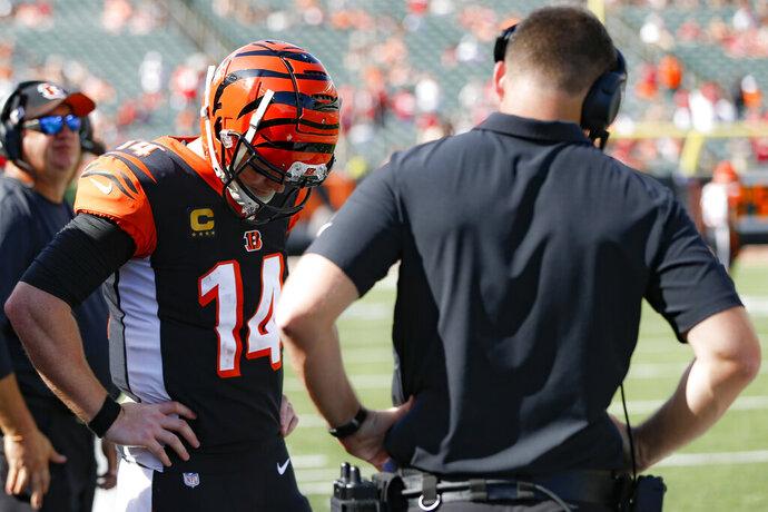 Cincinnati Bengals quarterback Andy Dalton (14) reacts alongside head coach Zac Taylor, right, after an NFL football game against the San Francisco 49ers, Sunday, Sept. 15, 2019, in Cincinnati. (AP Photo/Frank Victores)