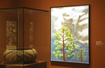 In this Wednesday, Oct. 23, 2019 photo, British artist David Hockney's Yosemite artistic work, right, along with baskets from weavers of the Miwok and Mono Lake Paiute tribes are on display at the Heard Museum, in Phoenix.