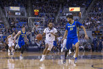 Nevada guard Corey Henson (2) brings the ball up as San Jose State center Craig LeCeBrae Ivey (25) defends during the first half of an NCAA college basketball game in Reno, Nev., Wednesday, Jan. 9, 2019. (AP Photo/Tom R. Smedes)