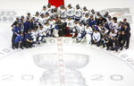 Tampa Bay Lightning players and team members pose with the Prince of Wales trophy after the team's overtime win over the New York Islanders in Game 6 of the NHL hockey Eastern Conference final, Thursday, Sept. 17, 2020, in Edmonton, Alberta. (Jason Franson/The Canadian Press via AP)