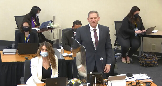 In this image taken from video, prosecutor Steve Schleicher introduces himself to potential jurors as Hennepin County Judge PeterCahill presides over jury selection, Monday, March 22, 2021, at the Hennepin County Courthouse in Minneapolis, in the trial of former Minneapolis police officer Derek Chauvin. Chauvin is charged in the May 25, 2020, death of George Floyd. (Court TV via AP, Pool)