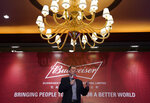 Jan Craps, Executive Director and CEO of Budweiser Brewing Company APAC Limited speaks during a press conference in Hong Kong Tuesday, Sept. 17, 2019. AB InBev, the world's largest brewer that produces Budweiser and Corona, has revived plans to list its Asian business in Hong Kong despite persistent pro-democracy protests but halved the size of its initial public offering. (AP Photo/Vincent Yu)
