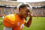 Tennessee quarterback Jarrett Guarantano (2) takes his helmet off as he makes his way to the locker room following his team's 45-0 win over UTC during a NCAA football game at Neyland Stadium on Saturday, Sept. 14, 2019 in Knoxville, Tenn.(C.B. Schmelter/Chattanooga Times Free Press via AP)