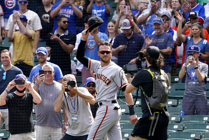 San Francisco Giants' Kris Bryant greets Chicago Cubs fans as he walks to the dugout before a baseball game in Chicago, Friday, Sept. 10, 2021. (AP Photo/Nam Y. Huh)
