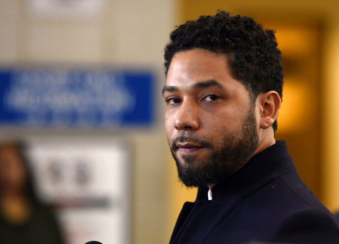 FILE - In this March 26, 2019, file photo, actor Jussie Smollett talks to the media before leaving Cook County Court after his charges were dropped, in Chicago. On Friday, July 19, 2019, lawyers for Smollett filed motions contending the actor was the victim of an attack in an effort to convince a judge to reverse his decision to appoint a special prosecutor in the case. (AP Photo/Paul Beaty, File)