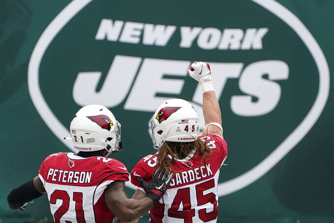 Arizona Cardinals linebacker Dennis Gardeck (45) celebrates alongside cornerback Patrick Peterson (21) after sacking New York Jets quarterback Joe Flacco during the first half of an NFL football game, Sunday, Oct. 11, 2020, in East Rutherford. (AP Photo/Seth Wenig)