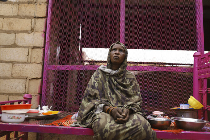 Saadia Ahmed, mother of the Sudanese migrant Mutawakel Ali, sits at her home, in Khartoum, Sudan, Friday April 30, 2021. Ali narrowly missed drowning in Libya because he was late for the boat's departure. The rubber boat when on to sink at sea on approximately April 21, and its more than 100 passengers drowned.  (AP Photo/Marwan Ali)