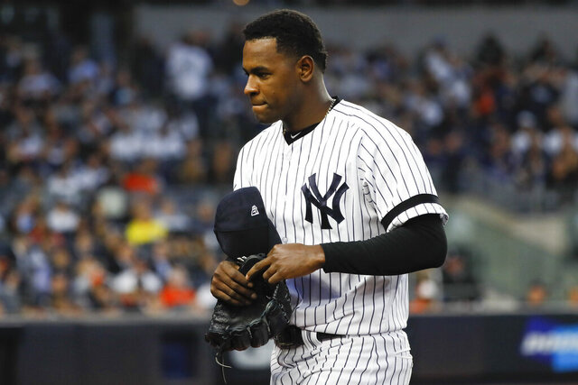 "FILE - In this Oct. 15, 2019, file photo, New York Yankees starting pitcher Luis Severino leaves the game against the Houston Astros during the fifth inning in Game 3 of baseball's American League Championship Series in New York. Severino needs Tommy John surgery and will miss the 2020 season, another setback for the two-time All-Star and the rotation of the AL East favorites. ""His plan is to have it done as soon as possible,"" Yankees general manager Brian Cashman said Tuesday, Feb. 25, 2020. (AP Photo/Matt Slocum, File)"