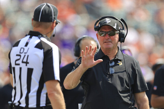 Minnesota Vikings head coach Mike Zimmer talks with an official in the first half of an NFL football game against the Cincinnati Bengals, Sunday, Sept. 12, 2021, in Cincinnati. (AP Photo/Aaron Doster)