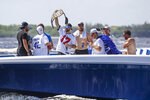 Tampa Bay Lightning left wing Alex Killorn holds a wrestling belt while celebrating the teams Stanley Cup victory with a boat parade Monday, July 12, 2021 in Tampa, Fla. (Dirk Shadd/Tampa Bay Times via AP)