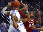 Kentucky's Keldon Johnson (3) and PJ Washington try to regain control of the ball near Arkansas' Daniel Gafford (10) during the first half of an NCAA college basketball game in Lexington, Ky., Tuesday, Feb. 26, 2019. (AP Photo/James Crisp)