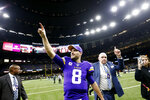 Minnesota Vikings quarterback Kirk Cousins (8) reacts as he walks off the field after their overtime win over the New Orleans Saints in an NFL wild-card playoff football game, Sunday, Jan. 5, 2020, in New Orleans. The Vikings won 26-20. (AP Photo/Butch Dill)