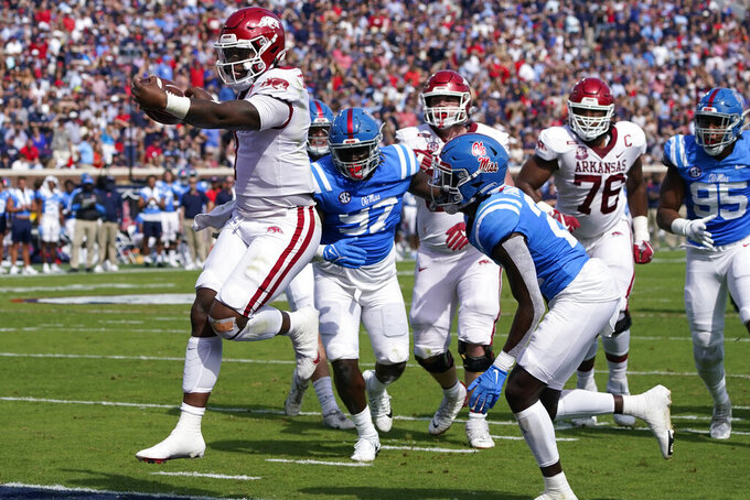 Arkansas quarterback KJ Jefferson (1) skips past Mississippi defenders on his way to a five-yard touchdown run during the first half of an NCAA college football game, Saturday, Oct. 9, 2021, in Oxford, Miss. (AP Photo/Rogelio V. Solis)