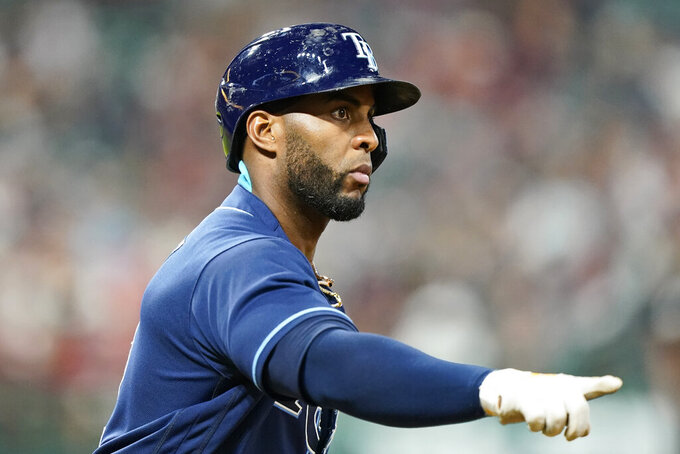 Tampa Bay Rays' Yandy Diaz points as he runs the bases after hitting a solo home run in the ninth inning of a baseball game against the Cleveland Indians, Thursday, July 22, 2021, in Cleveland. (AP Photo/Tony Dejak)