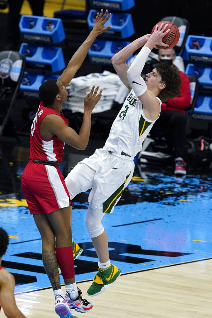 Baylor guard Matthew Mayer (24) shoots over Houston forward Fabian White Jr., left, during the first half of a men's Final Four NCAA college basketball tournament semifinal game, Saturday, April 3, 2021, at Lucas Oil Stadium in Indianapolis. (AP Photo/Darron Cummings)
