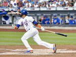 New York Mets' Jose Bautista watches his RBI single against the Washington Nationals during the first inning of a baseball game Thursday, July 12, 2018, in New York.(AP Photo/Julie Jacobson)
