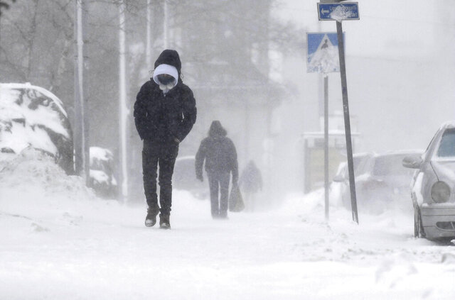 A thick layer of snow covers the streets of central Helsinki, Finland, making all kinds of travel difficult on Tuesday Jan. 12, 2021. The heavy snowfall is predicted to continue until Wednesday in Southern Finland. (Vesa Moilanen/Lehtikuva via AP)