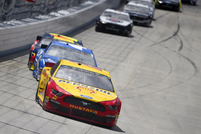 Driver Joey Logano (22) leads driver Kyle Larson (42) during the NASCAR Cup Series auto race, Monday, May 6, 2019, at Dover International Speedway in Dover, Del. (AP Photo/Will Newton)