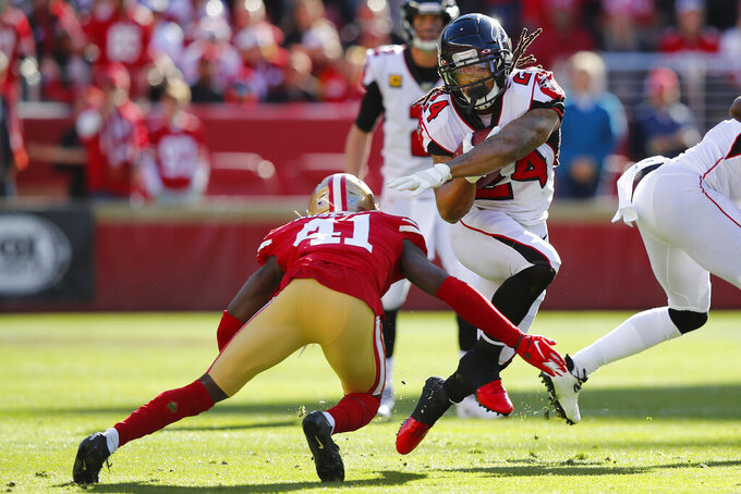 Atlanta Falcons running back Devonta Freeman (24) runs against San Francisco 49ers defensive back Emmanuel Moseley (41) during the first half of an NFL football game in Santa Clara, Calif., Sunday, Dec. 15, 2019. (AP Photo/John Hefti)