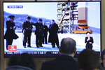A man watches a TV screen showing a file image of the North Korean leader Kim Jong Un at his county long-range rocket launch site during a news program at the Seoul Railway Station in Seoul, South Korea, Monday, Dec. 9, 2019. North Korea said Sunday it carried out a