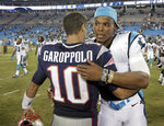 "FILE - In this Aug, 26, 2016, file photo, then-New England Patriots' Jimmy Garoppolo, left, and then-Carolina Panthers' Cam Newton, right, hug after a preseason NFL football game in Charlotte, N.C.  When quarterback Jimmy Garoppolo was Tom Brady's backup in New England, his teammates used to call him ""a gamer"" because of his ability to keep plays alive in the pocket and make throws under pressure. Now the player who was long assumed to be Brady's heir apparent returns to face his former team for the first time since being traded to the 49ers. He'll be trying to add to the recent struggles of Patriots team now led by Cam Newton that is below .500 through five games for the first time since 2001.  (AP Photo/Bob Leverone, File)"