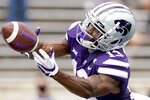 Kansas State wide receiver Chabastin Taylor (13) reaches for a pass during the first half of an NCAA college football game against Arkansas State Saturday, Sept. 12, 2020, in Manhattan, Kan. (AP Photo/Charlie Riedel)