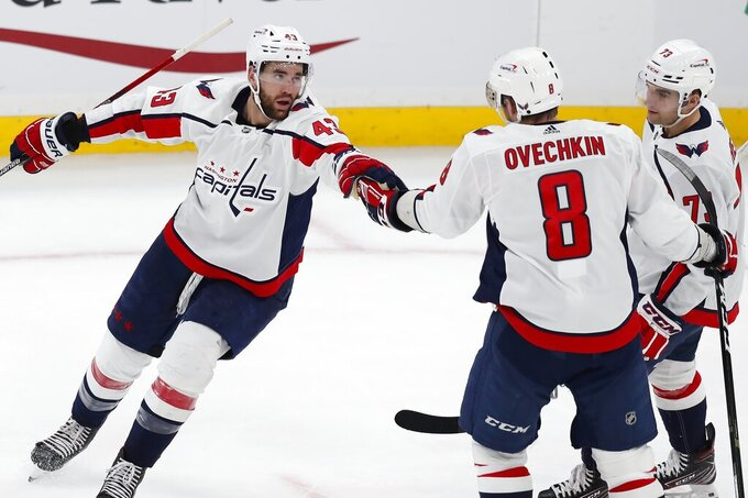 Washington Capitals' Tom Wilson (43) celebrates his goal with teammates Alex Ovechkin (8) and Conor Sheary (73) during the second period of an NHL hockey game against the Boston Bruins, Sunday, April 11, 2021, in Boston. (AP Photo/Michael Dwyer)