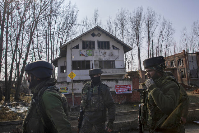 Indian army soldiers walk near the site of a gun battle on the outskirts of Srinagar, Indian controlled Kashmir, Wednesday, Dec. 30, 2020. A gun battle between rebels and government forces overnight killed three rebels on the outskirts of Srinagar on Wednesday, officials said. (AP Photo/ Dar Yasin)