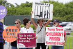 Protestors hold signs outside of the Homestead Temporary Shelter for Unaccompanied Children while members of Congress tour the facility, Monday, July 15, 2019, in Homestead, Fla. (AP Photo/Lynne Sladky)