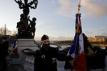 Gilbert, a French veteran stands before a ceremony held on the Alexandre III bridge in central Paris, Thursday Jan.7, 2021 to pay homage to two soldiers killed in Mali by an improvised explosive device that hit their armored vehicle on Saturday. Three other French soldiers died just five days earlier in similar circumstances. (AP Photo/Christophe Ena)