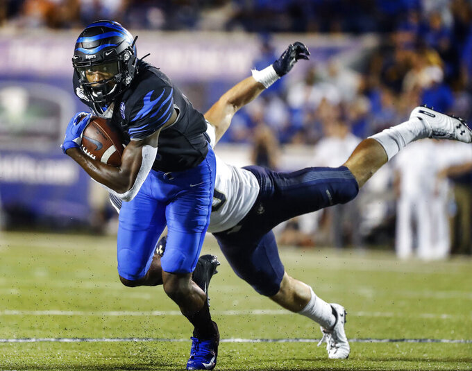Memphis receiver Damonte Coxie, left, runs for a touchdown after a catch in front of Navy defender Kevin Brennan during an NCAA college football game Thursday, Sept. 26, 2019, in Memphis, Tenn. (Mark Weber/Daily Memphian via AP)