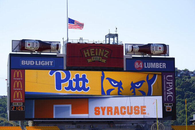 The U.S. flag flies at half-staff over Heinz Field before the start of an NCAA college football game between Pittsburgh and Syracuse , Saturday, Sept. 19, 2020, in Pittsburgh. Supreme Court Justice Ruth Bader Ginsburg died late Friday, Sept. 18, 2020. (AP Photo/Keith Srakocic)