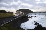 Cars move along a road by the sea in Horta, the capital of the Portuguese island of Faial, Tuesday, Oct. 1, 2019. The Category 2 hurricane is expected to hit the Atlantic Ocean Portuguese archipelago of the Azores Tuesday night and Wednesday morning. Lorenzo was previously a Category 5 hurricane, the strongest storm ever observed so far north and east in the Atlantic basin. (AP Photo/Joao Henriques)