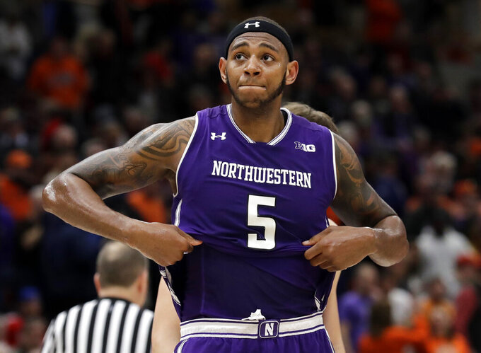 Northwestern center Dererk Pardon reacts as he looks to fans during overtime of an NCAA college basketball game in the first round of the Big Ten Conference tournament against Illinois in Chicago, Wednesday, March 13, 2019. Illinois won 74-69 in overtime. (AP Photo/Nam Y. Huh)