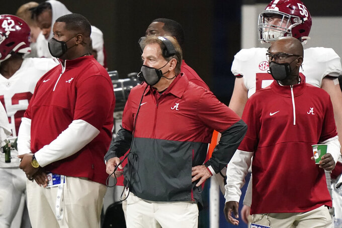 Alabama head coach Nick Saban, center, watches play against Florida during the first half of the Southeastern Conference championship NCAA college football game, Saturday, Dec. 19, 2020, in Atlanta. (AP Photo/Brynn Anderson)