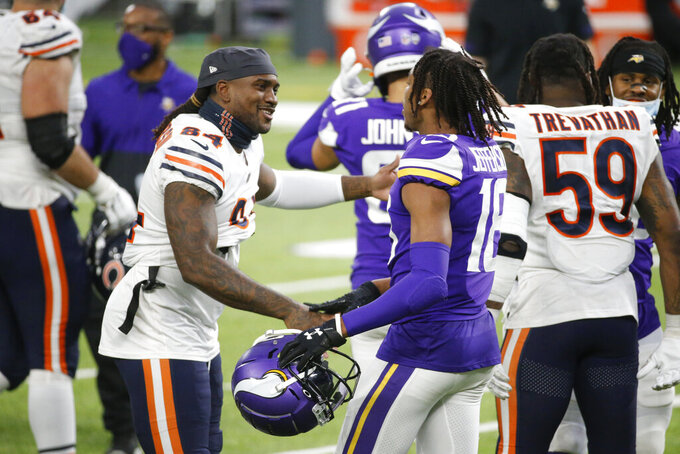 Chicago Bears wide receiver Cordarrelle Patterson (84) talks with Minnesota Vikings wide receiver Justin Jefferson (18) after an NFL football game, Sunday, Dec. 20, 2020, in Minneapolis. The Bears won 33-27. (AP Photo/Bruce Kluckhohn)