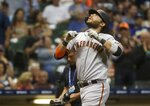 San Francisco Giants' Brandon Crawford reacts after hitting a home run during the ninth inning of a baseball game against the Milwaukee Brewers Friday, July 12, 2019, in Milwaukee. (AP Photo/Morry Gash)