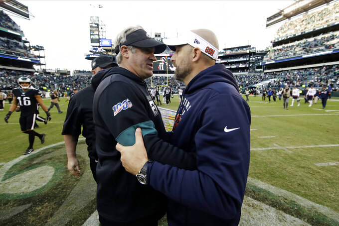Philadelphia Eagles head coach Doug Pederson, left, meets with Chicago Bears head coach Matt Nagy after an NFL football game, Sunday, Nov. 3, 2019, in Philadelphia. (AP Photo/Matt Rourke)