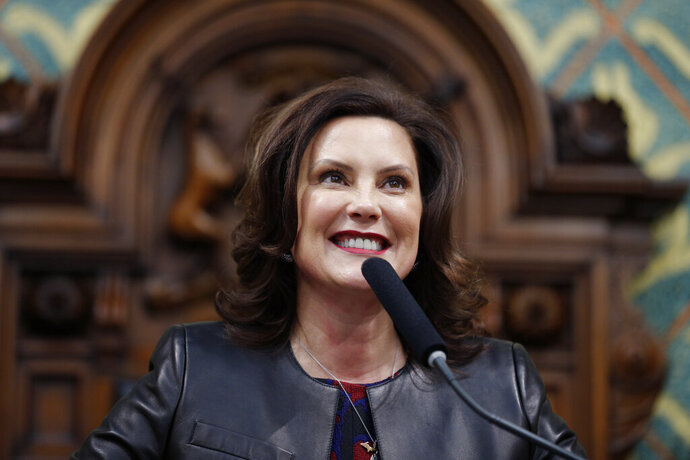 FILE - In this Jan. 29, 2020, file photo, Michigan Gov. Gretchen Whitmer delivers her State of the State address to a joint session of the House and Senate, at the state Capitol in Lansing, Mich. Whitmer announced Tuesday, Feb. 25, 2020, that Michigan will have a mobility officer to coordinate all initiatives related to self-driving and connected cars, an effort she said will ensure the state is the go-to place for testing and producing vehicles of the future. (AP Photo/Al Goldis, File)