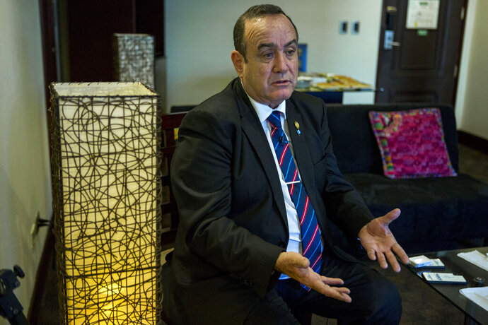 """Guatemala's President-elect Alejandro Giammattei gives an interview in Guatemala City, Tuesday, Aug. 13, 2019. Giammattei said Tuesday that Guatemala will not be able to hold up its side of an immigration agreement with the United States by serving as a """"safe third country"""" for asylum seekers. (AP Photo/Oliver de Ros)"""